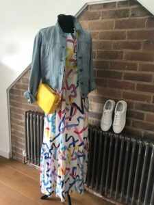Dress down a maxi dress with a denim jacket